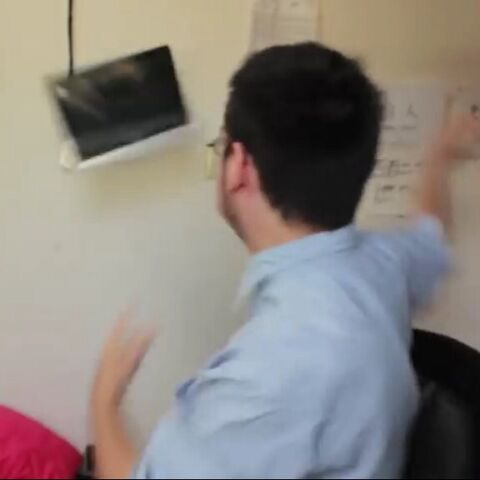 Frank throwing the 'Overpriced Mac Computer' across his room.