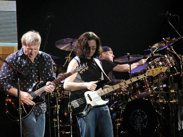 File:Rush-in-concert.jpg