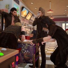 The party playing <i>Justice Monsters Five</i> in <i>Final Fantasy XV</i>.