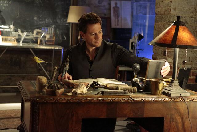 File:Henry sitting at his desk - Forever.jpg