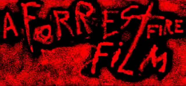 File:ForrestFireFilmPresentsSpiderVsSand.jpg