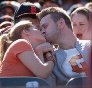 DJ and Matt kissing Giants Game 001
