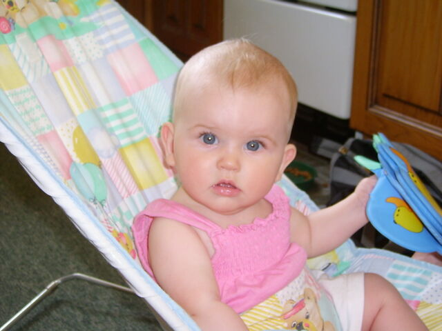 File:Sitting-in-bouncer-chair-5-five-month-stella-in-pink-summer-top-2-JR.jpg
