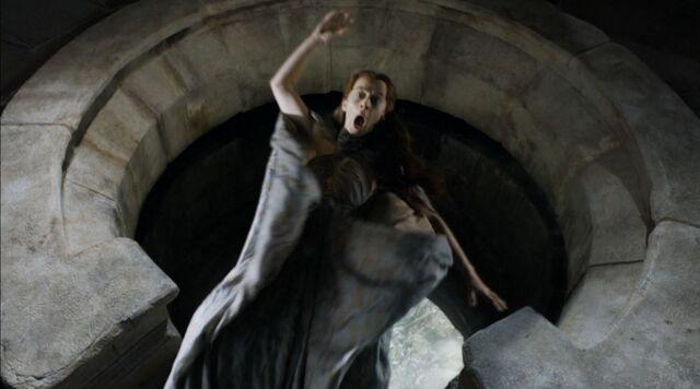 File:Game-Of-Thrones-S4Ep7-Mockingbird-Review-Kate-Dickie-as-Lysa-Arryn-thrown-out-of-the-moon-door.jpg
