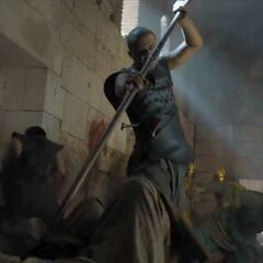 An injured Grey Worm continues to fight in