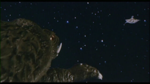 File:Gamera flies toward Zanon.jpg