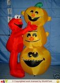 Gemmy inflatable elmo with pumpkin stack