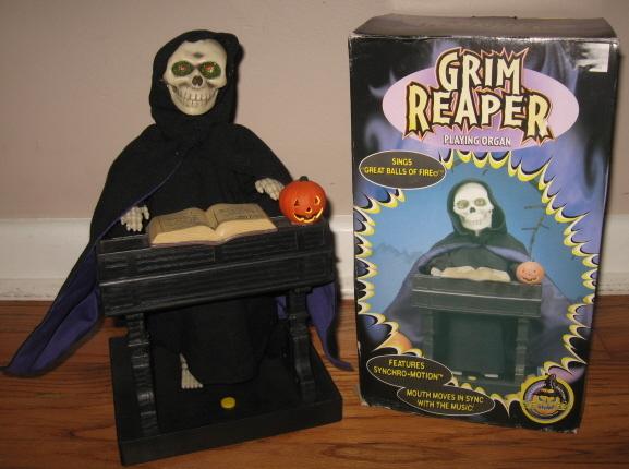File:Grim reaper playing organ.JPG