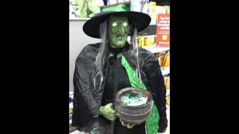 Lowes 2012 Gemmy Witch holding Misting Cauldron