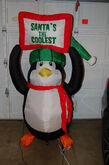 Gemmy inflatable penguin holding sign