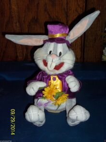 GEMMY DANCING SINGING LOONEY TUNES BUGS BUNNY PLUSH WITH PURPLE SUIT AND FLOWERS