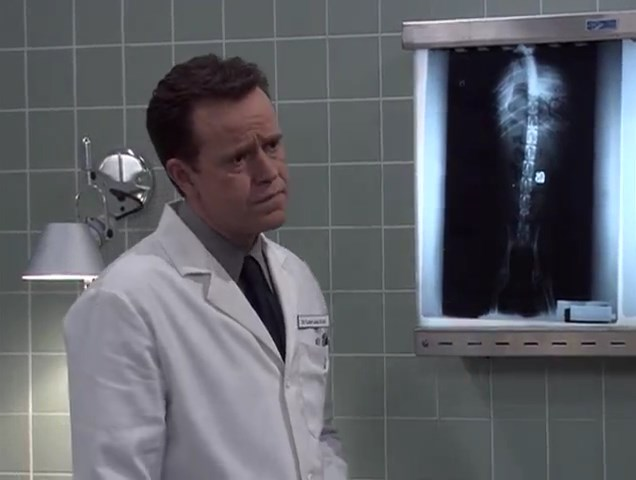 File:Ep 3x15 - Dr. Lisby finds the ring Mr. Needles swallowed.jpg