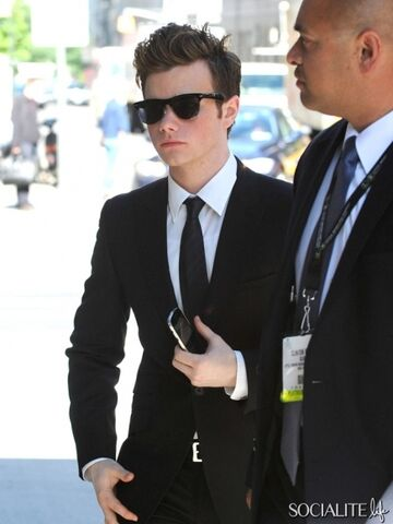 File:Chris-colfer-star-of-the-hit-tv-show-glee-sports-a-black-suit-and-dark-sunglasses-while-out-and-about-in-soho-2.jpeg