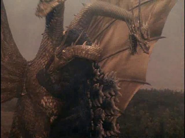 File:GvsKG-King Ghidorah coiling Godzilla.png