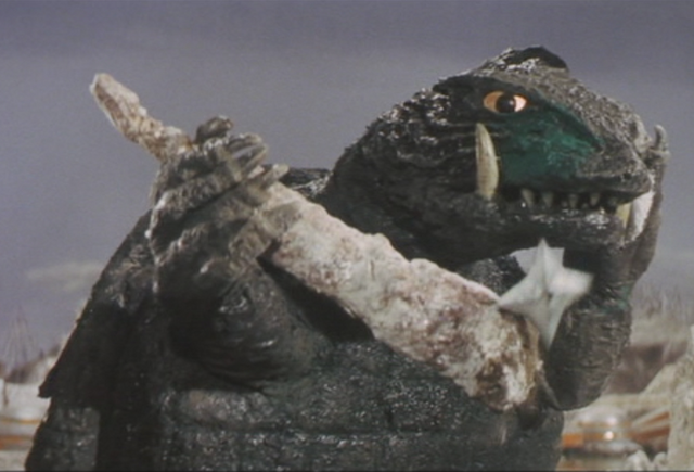 File:Gamera - 5 - vs Guiron - 26 - Gamera deflects a shuriken.png