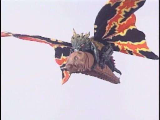 File:Battra carries Baby Mothra..jpg