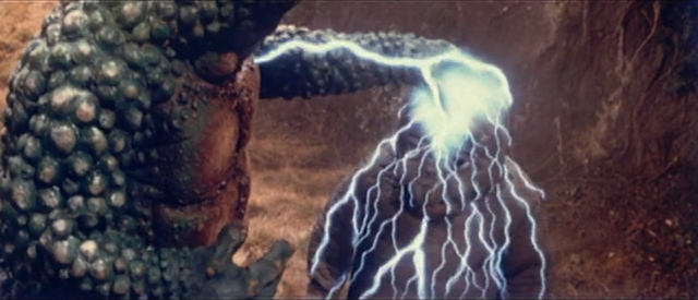 File:All Monsters Attack - Gabara electrifies Minilla.png