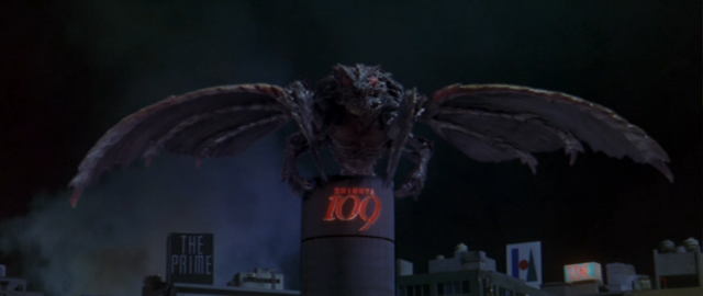 File:Godzilla vs. Megaguirus - Megaguirus rests atop the Shiesta 109 building.png