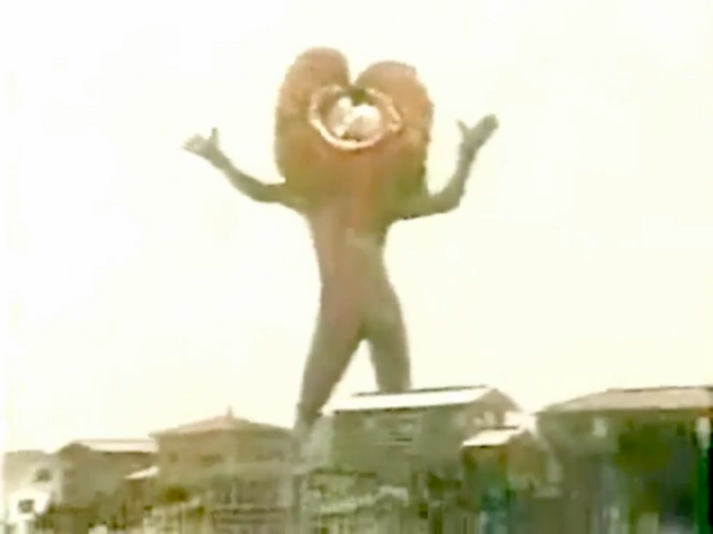 File:Greenman - Monsters - Baringa taunting Greenman in giant form.png