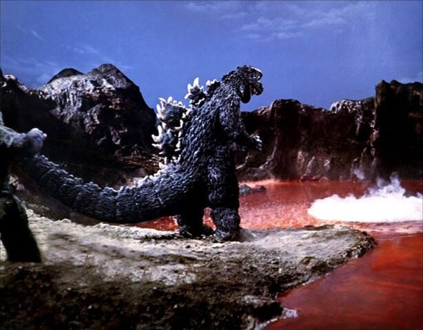 File:Son Of Godzilla - Godzilla Stands In Front Of A Red Lake.jpg