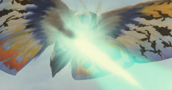 File:Rainbow Mothra firing his Multicolored Cross Heat Rainbow Laser Beams.jpg