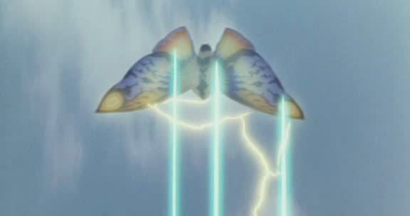 File:Rainbow Mothra emits his two Sparkling Rainbow Buster.jpg