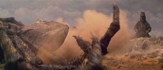 File:All Monsters Attack - Kumonga appears via stock footage 4 is down.png