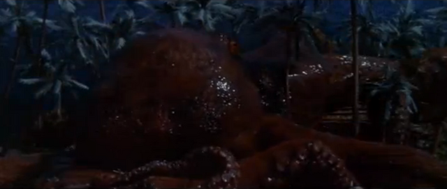 File:King Kong vs. Godzilla - 16 - Oodako Attacks Two People In A House.png