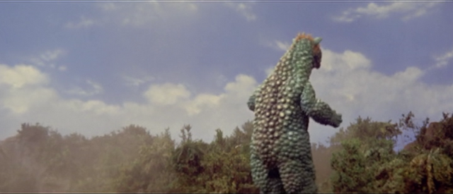 File:All Monsters Attack - Gabara walks away after beating up Minilla.png