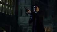 Penguin pointing his gun at Jim Gordon and Theo Galavan