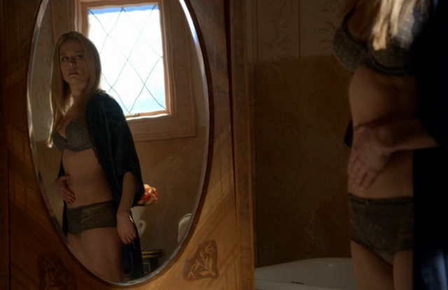File:221-Adalind looking at her stomach.png
