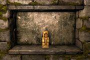Golden deity figure ig