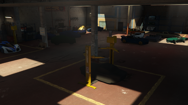 File:VehicleWarehouse-GTAO-InteriorOverview.png
