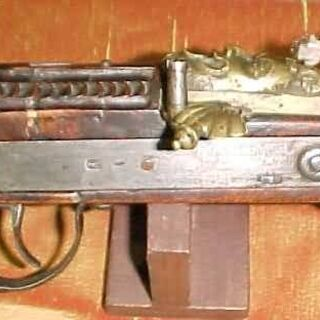 The side of a matchlock rifle.