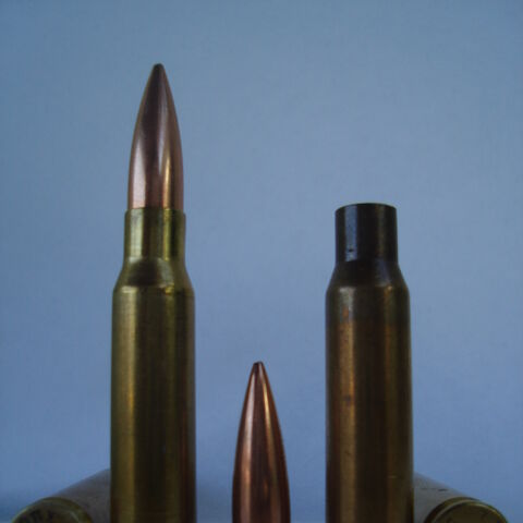 Left: .308 Winchester headstamp and cartridge. Center: 155 gr (10 g)Palma bullet. Right: 1971 Lake City, Match ammo headstamp and empty 7.62x51mm NATO round brass.