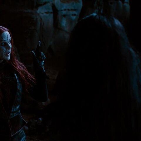 Redhead Witch senses Hansel and Gretel.
