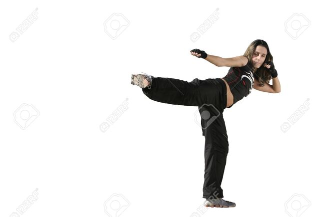 File:10927048-girl-fighting-in-a-white-background-Stock-Photo-kick-woman-fight.jpg