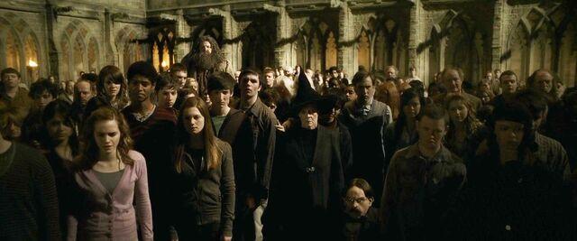 File:Hogwarts students raising wands.jpg