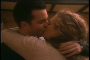 Nick and Jo share a kiss in Something of Value