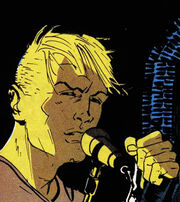 John Constantine singing into a microphone