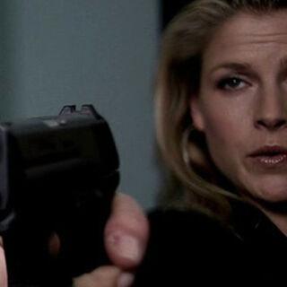 Nikki with a gun