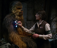 Chewbacca aided by a doctor