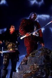 The Krugan(Clancy Brown) and Ramirez(Sean Connery) in Highlander.