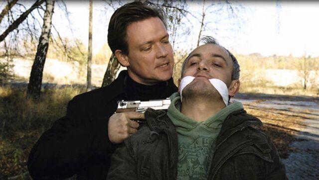 File:Burgdorf threatens Misch - actor.jpg