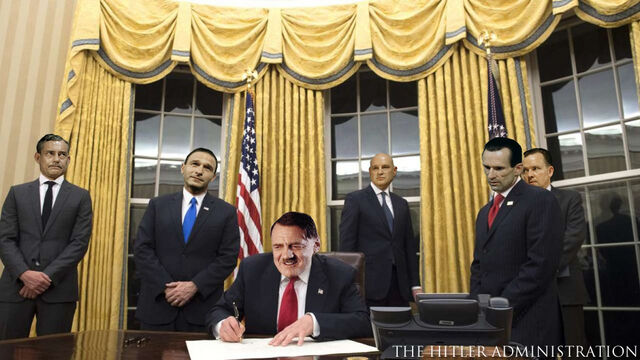 File:President Hitler signs his first executive order.jpeg