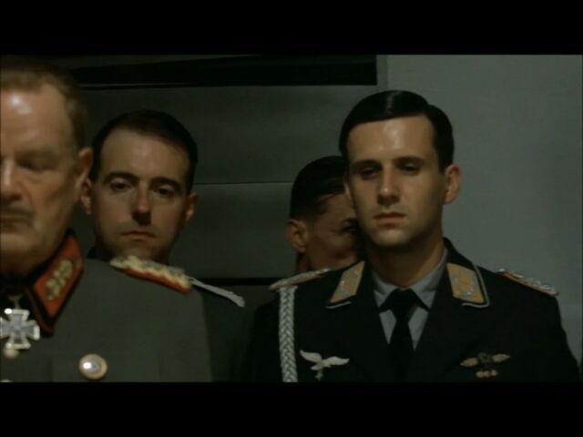 File:Hitler planning scene Mohnke enters the room behind Nicolaus von Below.jpg