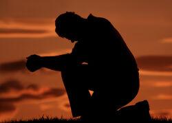Man-praying-on-one-knee1