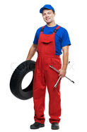 3002674-629148-serviceman-repairman-automobile-mechanic-with-car-tire-and-spanner-wrench-isolated