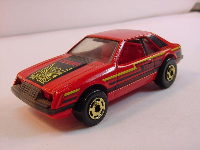 File:1983 turbo mustang metalflake red raised HK.jpg
