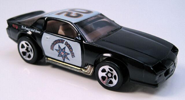 File:Blown camaro police car.JPG